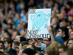 MANCHESTER, ENGLAND - Monday, April 30, 2012: A Manchester City supporter with a banner 'Mr Noisy Neighbour' against Manchester United during the Premiership match at the City of Manchester Stadium. (Pic by David Rawcliffe/Propaganda)