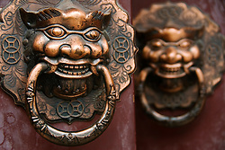 Detail of ornate door handles on house door in Beijing alleyway called a hutong