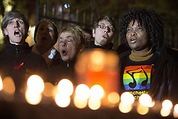 "© Licensed to London News Pictures . 01/12/2013 . Manchester , UK . The Manchester Lesbian and Gay Chorus sing . World AIDS Day commemoration in Sackville Park , Manchester , this evening (Sunday 1st December 2013) including a candle-lit procession around the city's "" Gay Village "" . Photo credit : Joel Goodman/LNP"