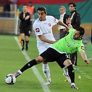 Karsiyakaspor's Ercag EVIRGEN (L) during their Play Off Second leg match at AliSamiYen Stadium in Istanbul Turkey on Thursday, 20 May 2010. Photo by TURKPIX