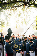 A cadet creates a sword arch for seniors walking to salute the war memorial after receiving their class rings on Friday, September 25, 2020.<br /> <br /> Credit: Cameron Pollack / The Citadel