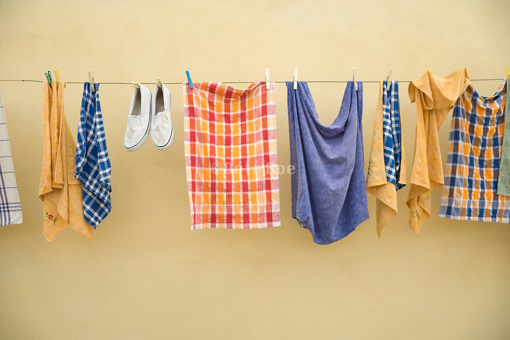 kitchen towels and one pair of shoes hanging to dry