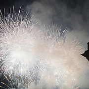 VENICE, ITALY - DECEMBER 31:   Fireworks display are seen in St. Mark's Square during New Year's Eve street party on December 31, 2011 in Venice, Italy.  Official figures says that around seventy thousand people gathered in St. Mark Square for this year's street celebrations.