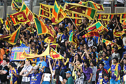 © Licensed to London News Pictures. 08/03/2012. Adelaide Oval, Australia. Sri Lankan fans waving their flags after the Sri Lankans scored a four during the One Day International cricket match final between Australia Vs Sri Lanka. Photo credit : Asanka Brendon Ratnayake/LNP