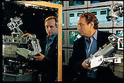 """Rodney Brooks of MIT (with the latest incarnation of Cog, his humanoid robot) believes it likely that robots can achieve humanlike intelligence and consciousness. But when that happens, he says, it will be unethical to have them work for us; we shouldn't treat our creations as our slaves. I think we're a long way from having to face it, but the landscape is going to be so unimaginable that it's hard to say sensible things."""" MIT, Cambridge, MA. From the book Robo sapiens: Evolution of a New Species, page 25."""