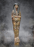 Ancient Egyptian Sarcophagus coffin of Tamutmutef, chantress of Amun, 18th Dynasty, (1550 to 1292 BC), Thebes. Egyptian Museum, Turin. <br /> <br /> The Tamutmutef sarcophagus belongs to a group of 18th Dynasty coffins characterised by the representation of the deceased wearing everyday clothes instead of as a mummy. It is carved in relief to reveal the pleated linen dress eith arms and feet sticking out from the pleats of the cloth. This coffin may have been reused from earlier use updated with dense yellow decorations.