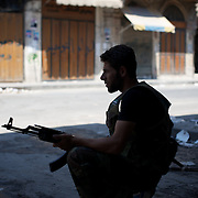 August 14, 2012 - Aleppo, Syria: A Free Syria Army (FSA) fighter on the spot for government snippers in Babal Nassar neighborhood in Aleppo's old city. The Syrian Army have in the past ten days increased their attacks on residential neighborhoods where Free Syria Army rebel fights have their positions in Syria's commercial capital, Aleppo. (Paulo Nunes dos Santos/Polaris)