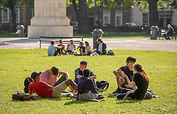 "© Licensed to London News Pictures; 21/09/2020; Bristol, UK. Two groups of six young people enjoy the sunshine and hot weather on the last official day of summer in Queens Square in Bristol city centre, amid concerns about a second wave of the covid-19 coronavirus pandemic across the UK, with many areas going into local lock down. From Monday 14 September it was illegal to meet up socially in groups of more than six people, known as the ""Rule of Six"", in order to try and contain the spread of the covid-19 coronavirus pandemic, and police have said they will enforce the law with fixed penalty notices which will increase for repeat offenders. Photo credit: Simon Chapman/LNP."