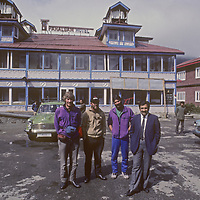 Gordon Wiltsie, Jay Jensen, Allan Pietrasanta and the manager of Pahalgam Hotel pose after the ski mountaineers finished a two-week traverse of the Great Himalaya Range, from Ladakh to Kashmir.  Wiltsie is suffering crushed vertebrae from an avalanche that engulfed the team, but in retrospect they were especially lucky to survive. A few months later a group of young trekkers was kidnapped from this town and never seen again.
