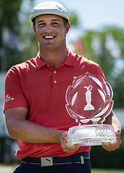 June 3, 2018 - Dublin, OH, U.S. - DUBLIN, OH - JUNE 03:  Bryson DeChambeau smiles as he holds the Memorial Tournament Trophy after the final round of the Memorial Tournament at Muirfield Village Golf Club in Dublin, Ohio on June 03, 2018. (Photo by Shelley Lipton/Icon Sportswire) (Credit Image: © Shelley Lipton/Icon SMI via ZUMA Press)
