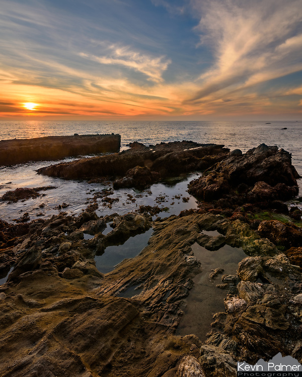 The sun sets over tidepools at Laguna Beach. I came here at low tide during a full moon, so the tide doesn't get much lower than this. Normally this part of Victoria Beach would be difficult to access as much of it would be underwater.