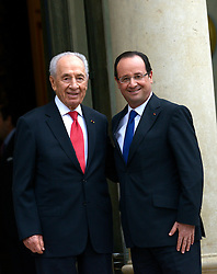 French President Francois Hollande welcomes his Israeli counterpart Shimon Peres before a meeting at the Elysee presidential palace in Paris, France on March 8, 2013. Photo by Mousse/ABACAPRESS.COM