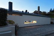 Modern house by night, illuminated window, external