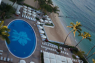 The Halekulani Hotel, the Hawaiian name meaning House Befitting Heaven, located on Waikiki beach in Honolulu, Hawaii offers stunning views of Diamond Head in a historic, secluded and exclusive setting. The oceanside swimming pool featuring the Halekulani's signature orchid comprised from over a million glass tiles.