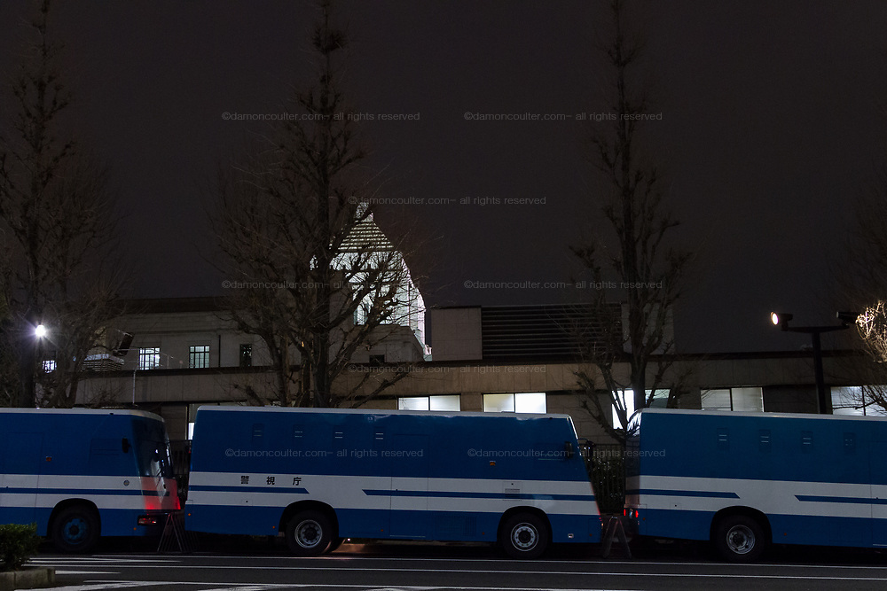 Police buses lined up in front of the National Diet Building as Hundreds of students and other activists protest outside the Japanese Prime Minister's office calling on the Japanese Prime Minister, Shinzo Abe and Finance Minister, Taro Aso to resign over a suspected cover-up of the Moritomo Gakuen school  land sale scandal and falsified documents. Kasumigaseki, Tokyo, Japan Friday, March 23rd 2018