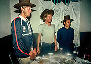 Tim Macartney-Snape (L) & Greg Mortimer - summiters of White Limbo / North face new route without oxygen, Chomolungma,  presented with Tibetan sombreros at dinner in Lhasa by Chinese Mountaineering Association, Tibet, October 1984.