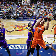 UNCASVILLE, CONNECTICUT- JULY 15: Alyssa Thomas #25 of the Connecticut Sun drives to the basket defended by Essence Carson #17 of the Los Angeles Sparks and Kristi Toliver #20 of the Los Angeles Sparks during the Los Angeles Sparks Vs Connecticut Sun, WNBA regular season game at Mohegan Sun Arena on July 15, 2016 in Uncasville, Connecticut. (Photo by Tim Clayton/Corbis via Getty Images)