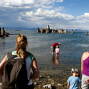 Mono Lake is over a million years old and is known for the rock like formations called tufas that rise from the water and are formed from calcium deposits. Visitors enjoy the lake.