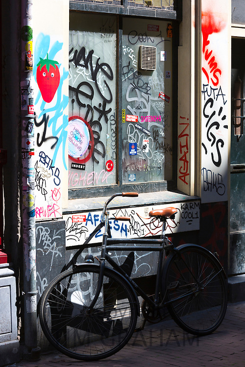 Graffiti on shop front in the Nine Streets shopping district, Amsterdam