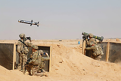 A U.S. Soldier assigned to the 3rd Cavalry Regiment and deployed in support of Combined Joint Task Force – Operation Inherent Resolve (CJTF-OIR) fires a Javelin anti-tank missile near Al Asad Air Base (AAAB), Iraq, Sept. 26, 2018. The Javelin was a part of a live-fire, react to contact training exercise involving M2A1 and M240B machine guns. AAAB is a CJTF-OIR enhanced partner capacity location dedicated to training partner forces and enhancing their effectiveness. (U.S. Army National Guard photo by 1st Lt. Leland White)