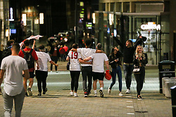 © Licensed to London News Pictures. 07/07/2021. Leeds, UK. Fans celebrate in Leeds city centre as England beat Denmark 2-1 after extra time, reaching their first major final since 1966. Photo credit: Adam Vaughan/LNP