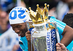 © Licensed to London News Pictures. 25/05/2015. London, UK. DIDIER DROGBA holding the premiere league cup. . The Chelsea FC first team and manager Jose Morihno parade the 2014/15 Premier League trophy and the Capital One Cup through the streets of West London in an open top bus to celebrate their seasons achievements.  Photo credit: Ben Cawthra/LNP