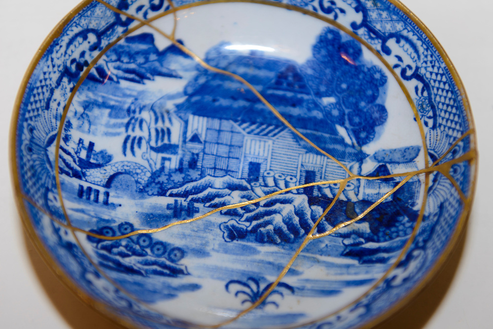 """A saucer repaired with kintsugi. Kintsugi event, Daiwa Anglo-Japanese Foundation, London, UK, January 24, 2014. Kintsugi literally means """"joining with gold"""": a technique to piece together broken pottery or glass with lacquer, rice-glue and gold."""