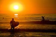 Surfers enjoy San Diego's Scripps Beach in La Jolla, Oct. 6, 2005.