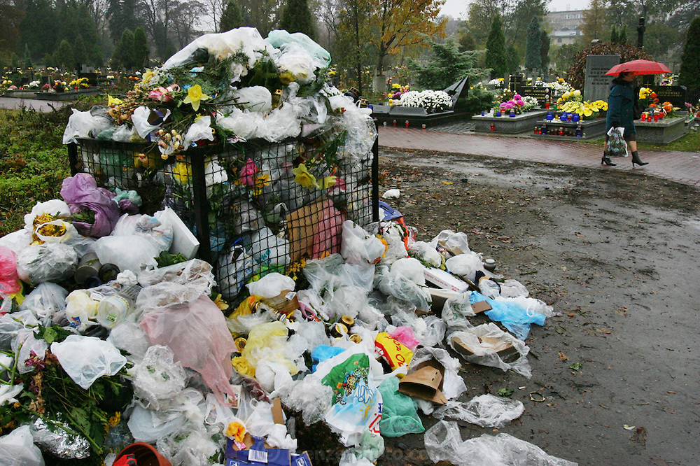 Lodz, Poland cemetery the day after All Saints Day. The day after, trash bins are full from grave clean-ups.