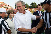 DALLAS, TX - AUGUST 30: Former President George W. Bush and wife Laura Bush shake hands with officials before kickoff between the SMU Mustangs and the Texas Tech Red Raiders on August 30, 2013 at Gerald J. Ford Stadium in Dallas, Texas.  (Photo by Cooper Neill/Getty Images) *** Local Caption *** George W. Bush; Laura Bush