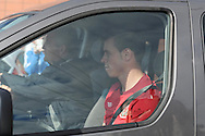 Gareth Bale leaves training in a car separate from his teammates after the Wales football team training at the FAW base, Dragon Park in Newport, South Wales on Monday 12th August 2013. pic by Andrew Orchard,  Andrew Orchard sports photography,