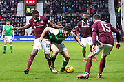 John McGinn (#7) of Hibernian holds off the challenge of Arnaud Djoum (#10) of Heart of Midlothian during the William Hill Scottish Cup 4th round match between Heart of Midlothian and Hibernian at Tynecastle Stadium, Gorgie, Scotland on 21 January 2018. Photo by Craig Doyle.