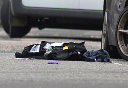 © Licensed to London News Pictures. 15/10/2015. London, UK. ITEMS OF CLOTHING at the scene of a shooting in Haggerston, Hackney on the corner of Lovelace Street and Haggerston Road where a police officer was shot during an armed operation. Photo credit : Vickie Flores/LNP