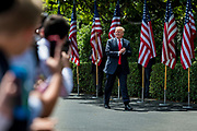 """President Donald Trump applauds to the audience as he arrives during a """"Celebration of America"""" event on the South Lawn of the White House on June 5, 2018 in Washington, DC. The celebration is being staged as a replacement for a White House visit by the Super Bowl champion Philadelphia Eagles. Some of the team was planning on boycotting the event due to the President's stance on players kneeling during the National Anthem at NFL games, so Trump resented their invitation.      Photo by Pete Marovich/UPI"""