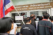 Anti-government protestors try to get into the Bureau of the Budget office in the Ministry of Finance complex. The Budget Bureau is the budgetting office of the Prime Minister. Protestors opposed to the government of Thai Prime Minister Yingluck Shinawatra spread out through Bangkok this week. Protestors have taken over the Ministry of Finance, Ministry of Sports and Tourism, Ministry of the Interior and other smaller ministries. The protestors are demanding the Prime Minister resign, the Prime Minister said she will not step down. This is the worst political turmoil in Thailand since 2010 when 90 civilians were killed in an army crackdown against Red Shirt protestors. The Pheu Thai party, supported by the Red Shirts, won the 2011 election and now govern. The protestors demanding the Prime Minister step down are related to the Yellow Shirt protestors that closed airports in Thailand in 2008.