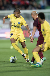 METZ, Sept. 9, 2017  Kylian Mbappe (L) of Paris Saint Germain vies for the ball during the match between Metz and Paris Saint Germain of French Ligue 1 2017-2018 season 5th round in Metz, France on Sept. 8, 2017. Paris Saint Germain won 5-1. (Credit Image: © Jack Chan/Chine Nouvelle/Xinhua via ZUMA Wire)