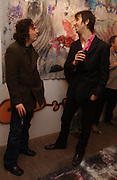 James Macnair and Joseph Arthur ( pink shirt)  at the private view for artist Joseph Arthur's   exhibition at the Vertigo Gallery, Gt. Eastern St.  on February 9 2006. ONE TIME USE ONLY - DO NOT ARCHIVE  © Copyright Photograph by Dafydd Jones 66 Stockwell Park Rd. London SW9 0DA Tel 020 7733 0108 www.dafjones.com