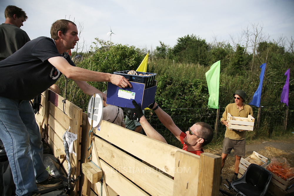 Climate Camp 2008.Food has to be carried along the road from Hoo and into the camp because of police obstructions.
