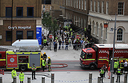 © Licensed to London News Pictures. 05/06/2014. London, UK. People have to be evacuated from The Shard  following a fire alert reporting smoke in the basement of the skyscraper. Photo credit : LNP