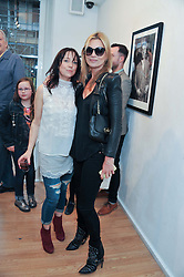 Left to right, DEBBI CLARK and KATE MOSS at a private view of portrait photographs by Debbi Clark in support of the Sir Hubert von Herkomer Arts Foundation, held at The Strand Gallery, 32 John Adam Street, London WC2Non 8th May 2013.