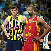 Fenerbahce's Darjus LAVRINOVIC (L) and Galatasaray CC's Preston SHUMPERT (R) during their Turkish Basketball Legague Play-Off final fifth match Fenerbahce between Galatasaray at the Sinan Erdem Arena in Istanbul Turkey on Tuesday 14 June 2011. Photo by TURKPIX