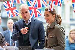 The Duke and Duchess of Cambridge meet traders during a walkabout in Keswick town centre as part of a visit to Cumbria.