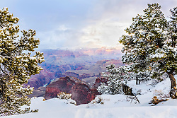 Clearing winter storm at the South Rim of the Grand Canyon. Winter is magic when glistening snow meets the desert red rock of the Colorado Plateau