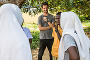 ICS volunteer Joe Radcliffe observing students during a mid class role play session at Mingoyo school as part of the VSO / ICS Elimu Fursa project (Opportunities in Education) Lindi, Lindi region. Tanzania.