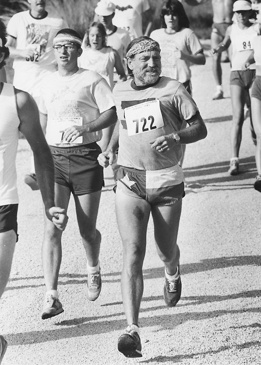 ©1980 Willie Nelson jogging at Briarcliff Country Club west of Austin.