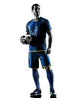 one caucasian soccer player man standing in silhouette isolated on white background