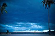 A woman watches the storm coming over Nha Trang, Vietnam, Asia