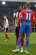 Crystal Palace forward Wilfried Zaha (11) faces off Grimsby Town midfielder Mitch Rose (8) during the The FA Cup 3rd round match between Crystal Palace and Grimsby Town FC at Selhurst Park, London, England on 5 January 2019.