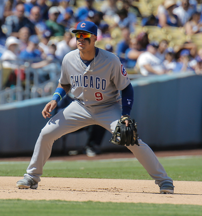 Aug 28 2016 - Los Angeles U.S. CA - Chicago Cubs 3B # 9  Javier Baez double-clutched before throwing to late-arriving second baseman Ben Zobrist. Umpires ruled Corey Seager beat Zobrist and the ball to the bag, allowing Toles to score, and a review upheld the call.  during MLB game between LA Dodgers and the Chicago Cubs 1-0 lost at Dodgers Stadium Los Angeles Calif. Thurman James / CSM