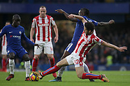 Ramadan Sobhi of Stoke City and Victor Moses of Chelsea and N'golo Kante of Chelsea (l) battle for the ball.<br /> Premier league match, Chelsea v Stoke city at Stamford Bridge in London on Saturday 30th December 2017.<br /> pic by Kieran Clarke, Andrew Orchard sports photography.